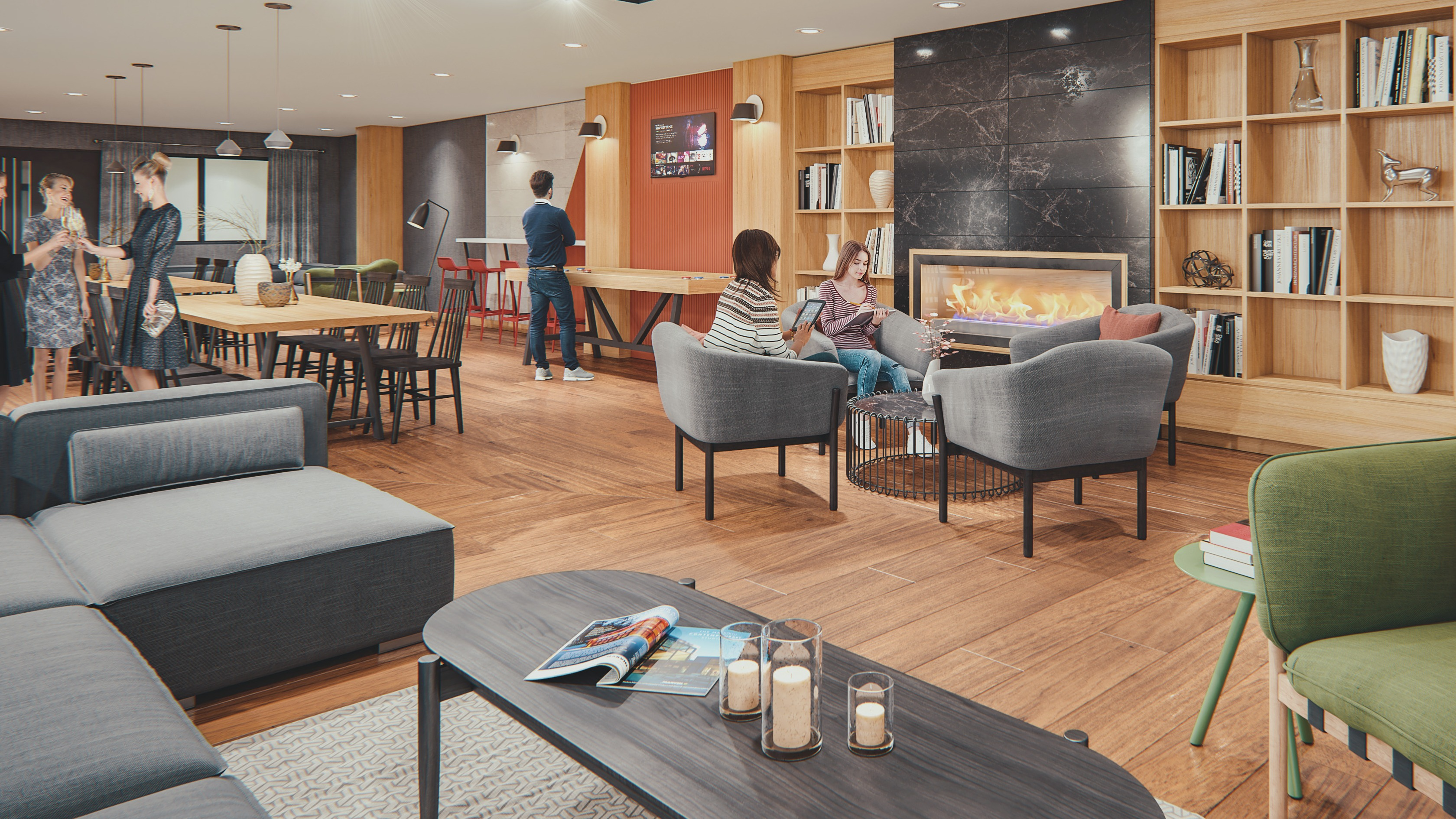 Party room with fire place, built in bookshelves, couches and lounge chairs