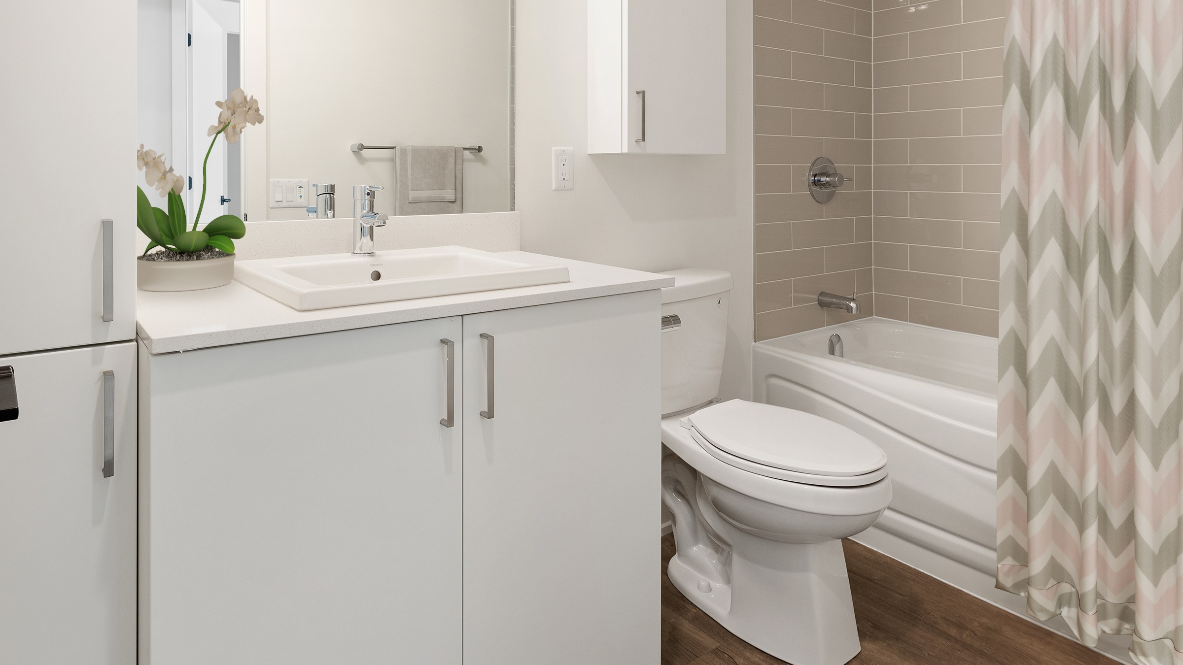 Full bathroom with sink, toilet and shower with a bath tub
